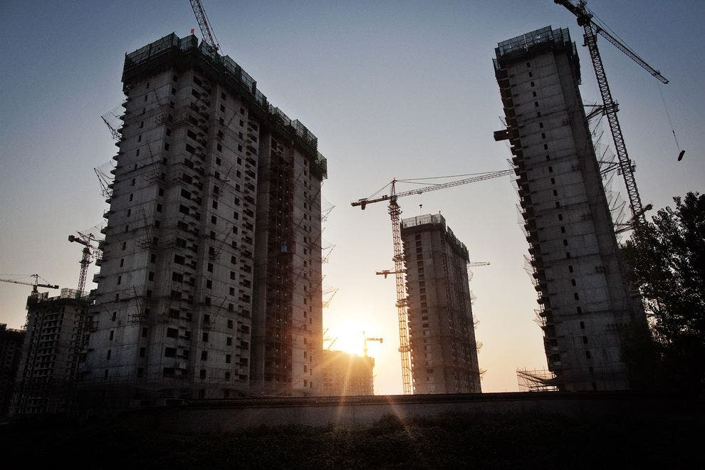 New apartment blocks are rapidly being built in Beijing, China. Currently the world's most populous country, China is projected to experience population decline this century. ( MARCUS BLEASDALE, VII)
