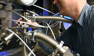 "Dr. Matt Wolford, a chemist at the U.S. Naval Research Laboratory, is investigating if an electron beam originally built for nuclear fusion research can also be used to clean up coal power plant NOx emissions. ""This is an opportunity for NRL to a get a technology that we developed here out in the real world,"" says Dr. John Sethian, who leads the project.  (Photo: U.S. Naval Research Laboratory/Jamie Hartman)"