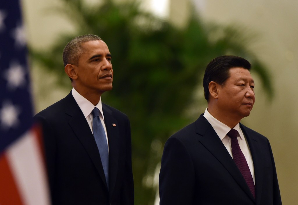 President Obama stands with Chinese President Xi Jinping as they listen to the Chinese national anthem during a welcome ceremony in the Great Hall of the People in Beijing on Wednesday. (Greg Baker/Agence France-Presse via Getty Images)
