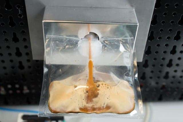 Hot, fresh espresso served in a plastic pouch. Credit: Lavazza