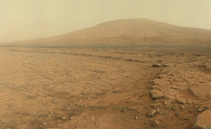 Stunning panoramic view of Mount Sharp at a distance taken by Curiosity rover. Credit: NASA