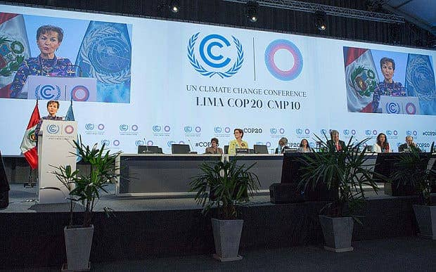 Christiana Figueres (L), executive secretary of the United Nations Framework Convention on Climate Change (UNFCCC) addresses the opening meeting of the plenary session Photo: Xinhua News Agency/REX