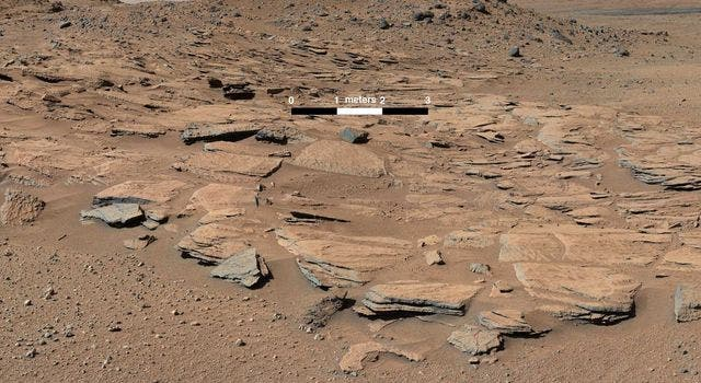 This image from Curiosity's Mastcam shows inclined beds of sandstone interpreted as the deposits of small deltas fed by rivers flowing down from the Gale Crater rim and building out into a lake where Mount Sharp is now. Credit: NASA/JPL-Caltech/MSSS