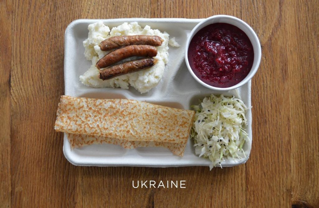 Mashed potatoes with sausage, borscht, cabbage and syrniki (a dessert pancake).