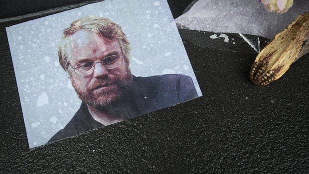 A photo of actor Philip Seymour Hoffman, as part of a makeshift memorial in front of his apartment building in New York. Hoffman died of a heroin overdose last February, a tragedy which put overdose back into media attention. REUTERS