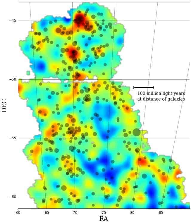 The map traces the distribution of dark matter across a portion of the sky. The color scale represents projected mass density: red and yellow represent regions with more dense matter.
