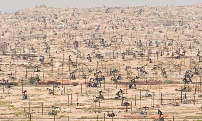 Depleting oil fields are yet another symptom of ecological overshoot as seen at the Kern River Oil Field in California. Photograph: Mark Gamba/Corbis