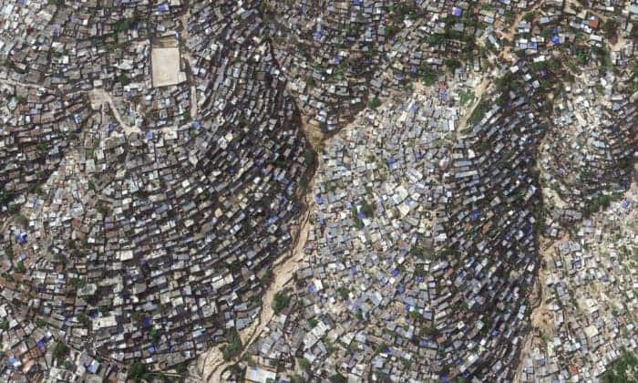 Slum-dwelling residents of Port-au-Prince, Haiti, face bleak living conditions in the western hemisphere's poorest country. Photograph: Google Earth/2014 Digital Globe