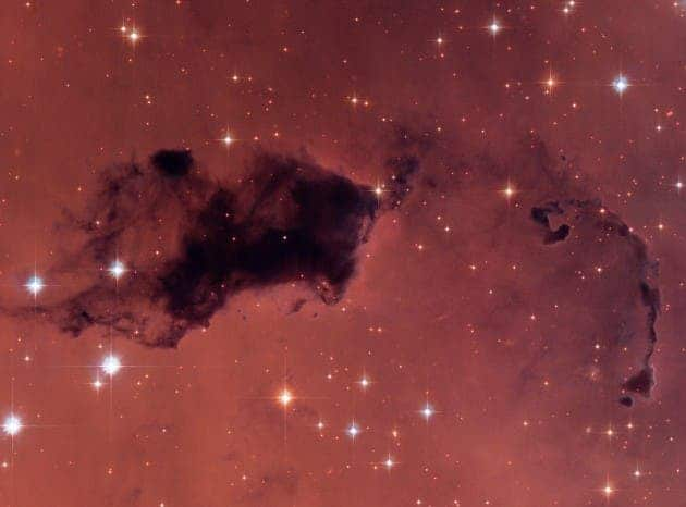 "This Hubble image features dark knots of gas and dust known as ""Bok globules,"" which are dense pockets in larger molecular clouds. Similar islands of material in the early universe could have held as much water vapor as we find in our galaxy today, despite containing a thousand times less oxygen. (Photo by NASA, ESA, and The Hubble Heritage Team)"