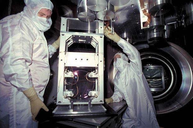 Scientists  install optics inside laser beam splitter chamber at the Livingston Laser Interferometer Gravitational Wave Observatory as part of a $205 million upgrade. (Livingston LIGO Observatory)