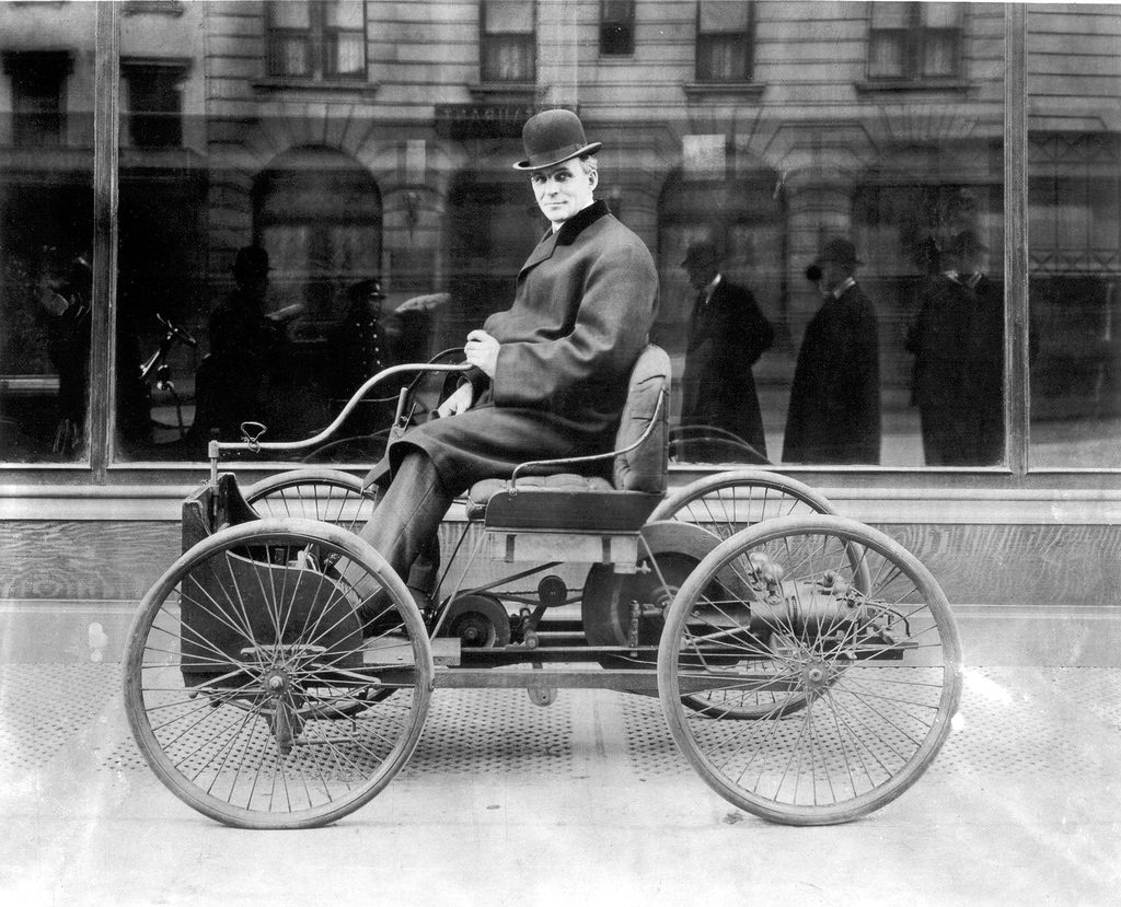 Henry Ford on his 1896 Quadricycle, one of two built. Image: Wikimedia Commons