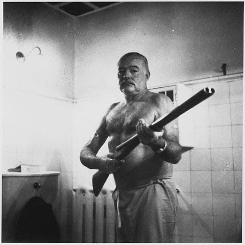 Hemingway with a shotgun. Circa 1950.