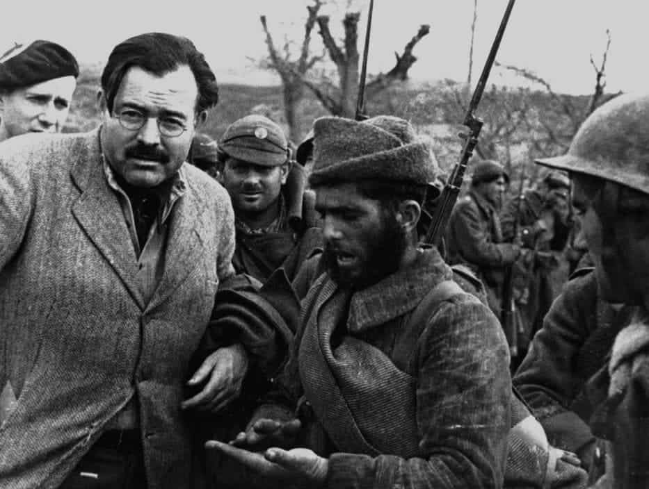 US writer and journalist Ernest HEMINGWAY with soldiers at the front lines. December 1937.