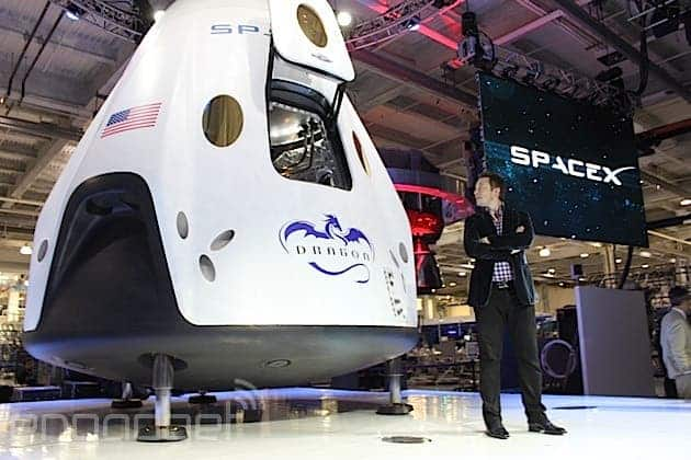 SpaceX CEO, Elon Musk, proudly sitting next to the Dragon Capsule. Image: SpaceX