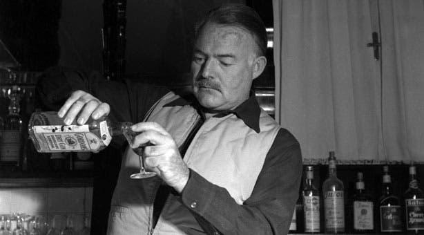 Hemingway having a drink