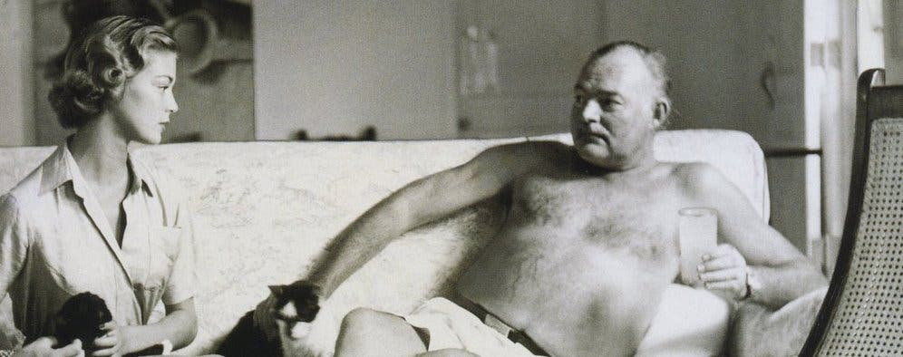 Hemingway enjoy in a Papa Doble in the company of a charming lady.