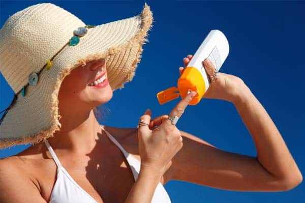 woman sunscreen beach