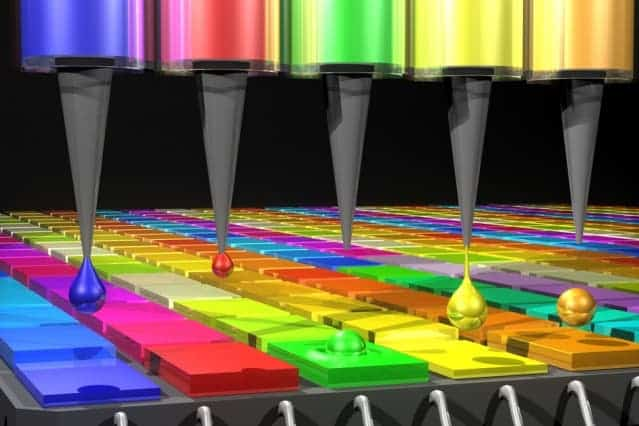 In this illustration, the Quantum Dot (QD) spectrometer device is printing QD filters — a key fabrication step.  The dots are made by printing droplets. Image: MIT