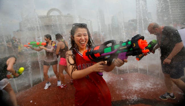 A water fight in Shanghai on July 21st, near the beginning of a record heat wave in China. (Carlos Barria/Reuters)