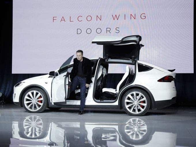 Elon Musk stepping out of the Model X. Image: AP/Marcio Jose Sanchez