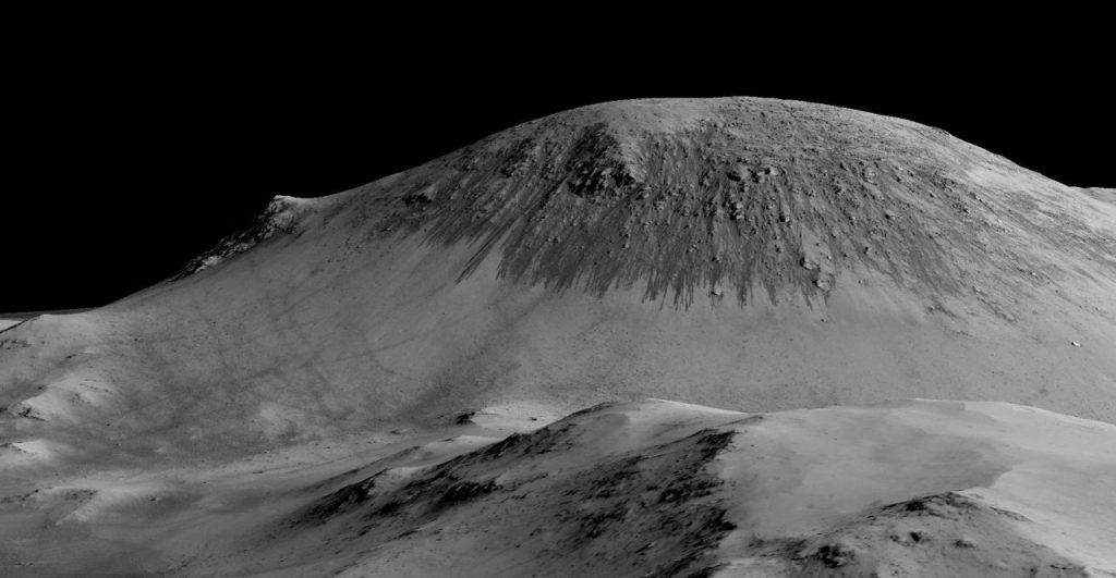 Dark narrow streaks called recurring slope lineae seen here flowing on a Martian mountain. Image: NASA/JPL