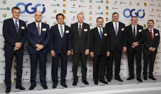 The CEOs of ten of the biggest oil and gas companies in the world. The shot was taken shortly after the group delivered a joint statement urging UN states to tackle global warming by reducing their emissions. Image: REUTERS/JACKY NAEGELEN