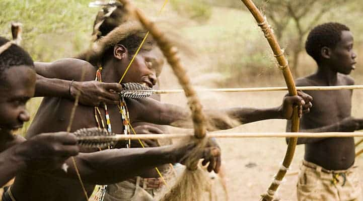 Hadza hunter gathers. They grow no food, raise no livestock, and live without rules or calendars. They are living a hunter-gatherer existence that is little changed from 10,000 years ago. Image: Bellenews