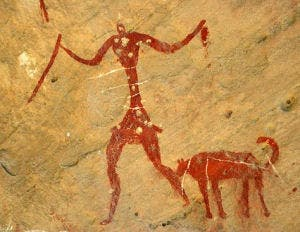 Ancient cave painting showing a hunter and his dog (undated). Image: ScienceaGoGO
