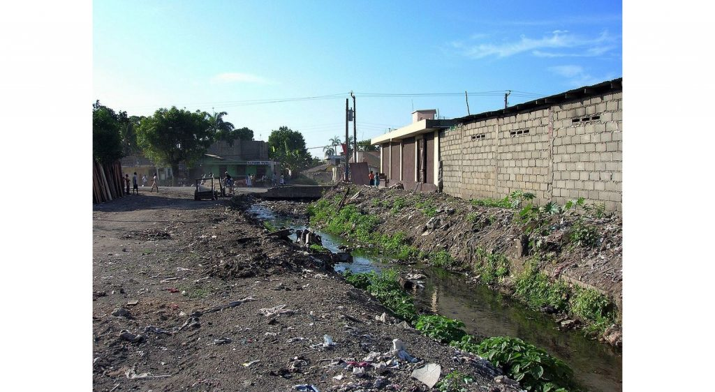 'Poor sanitation in Cap-Haitien' by Rémi Kaupp - Self-photographed. Licensed under CC BY-SA 3.0 via Commons