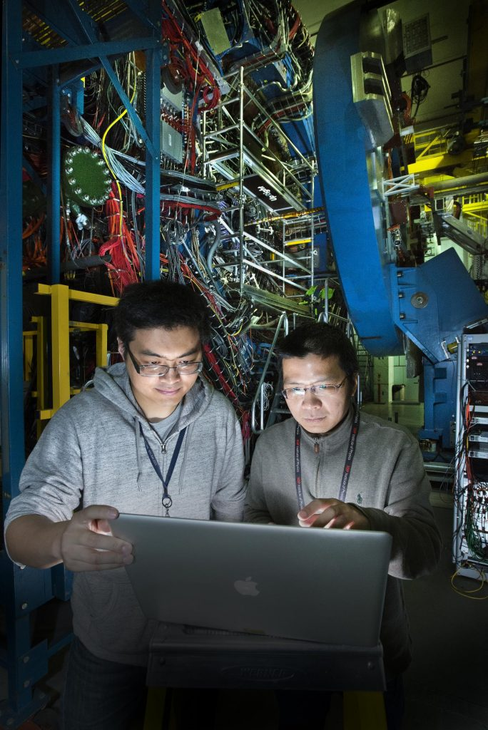 Zhengqiao Zhang, a graduate student from the Shanghai Institute of Applied Physics, with STAR physicist Aihong Tang at the STAR detector of the Relativistic Heavy Ion Collider (RHIC). Credit: Brookhaven National Laboratory antimatter.