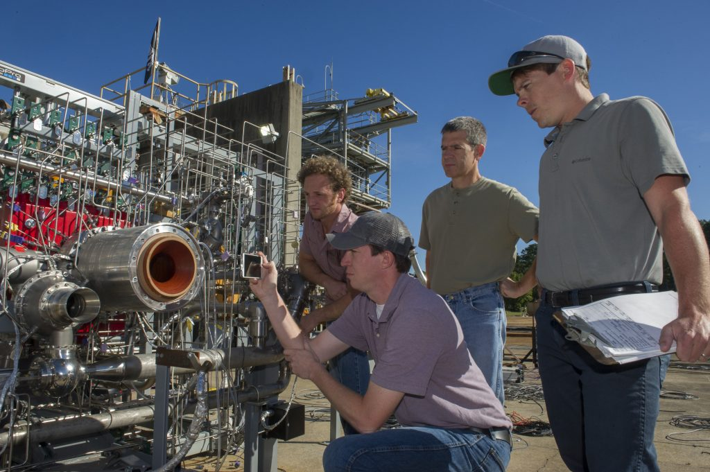 Engineers prepare a 3-D printed breadboard engine made up of 75 percent of the parts needed to build a rocket engine for a test at NASA's Marshall Space Flight Center in Huntsville, Alabama. Credits: NASA/MSFC/Emmett Given