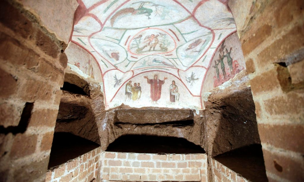 A fresco in the restored Catacombs of Priscilla, Rome. Part of a separate labyrinth of Roman tombs has been damaged by illegal dumping. Image via theguardian