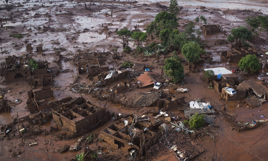 Homes lay in ruins after two dams burst, flooding the small town of Bento Rodrigues in Minas Gerais state, Brazil. Photograph: Felipe Dana/AP