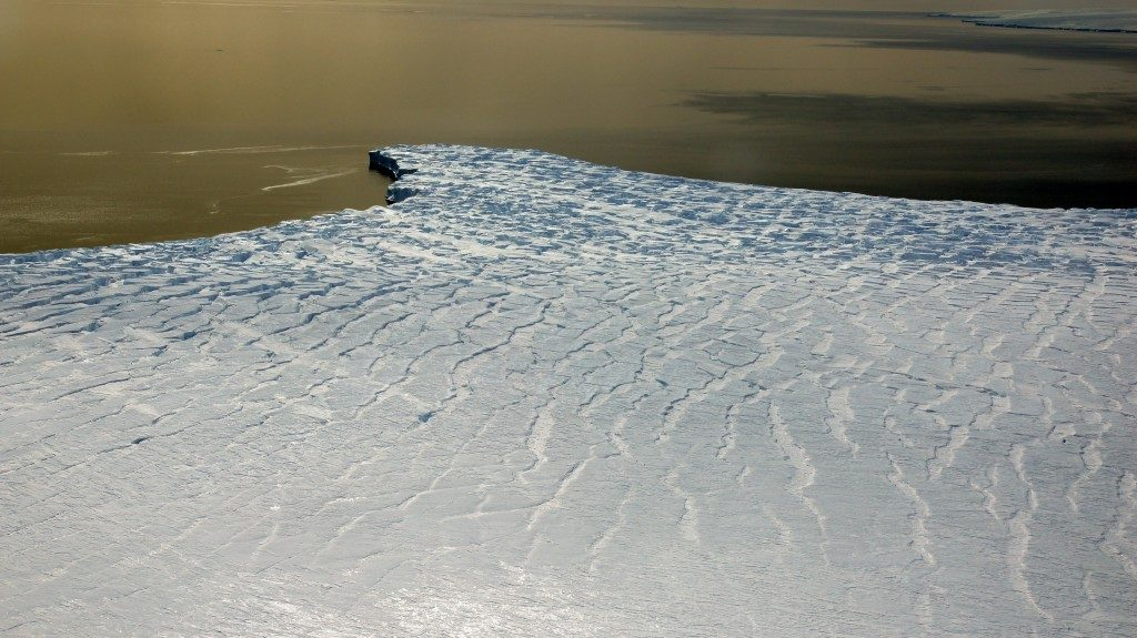 Highly crevassed ice front of Ferrigno Ice Stream in the Bellingshausen Sea. Picture taken during the airborne NASA IceBridge campaign on November 16, 2011. Credit: Matthias Braun, University of Erlangen-Nuremberg, Germany.