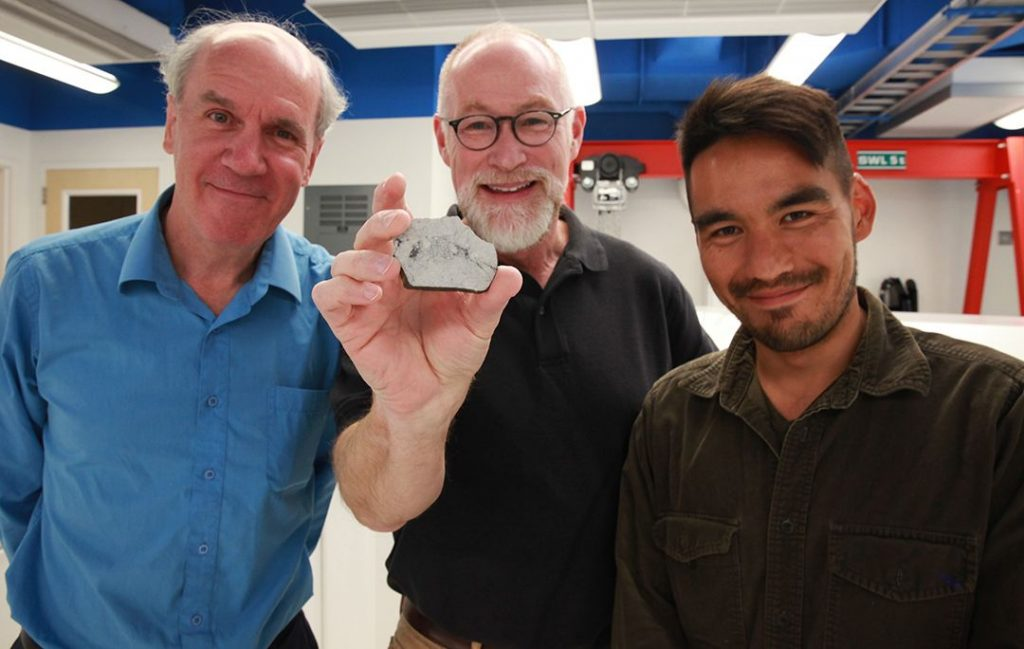 Paul Warren, Edward Young (holding a sample of a rock from the moon) and Issaku Kohl. Credits: Christelle Snow/UCLA