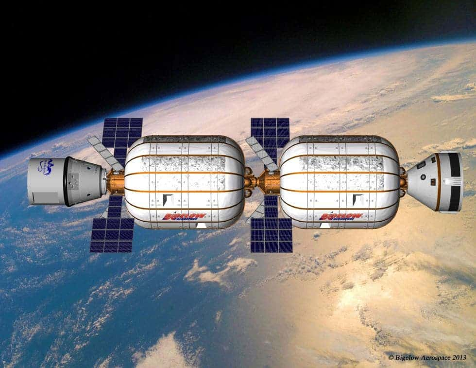 Artist rendering of two B330 modules  with a Boeing CST-100 and SpaceX Dragon spacecraft docked. One B330 provides nearly as much living space as the entire space station. Image: Bigelow Aerospace.