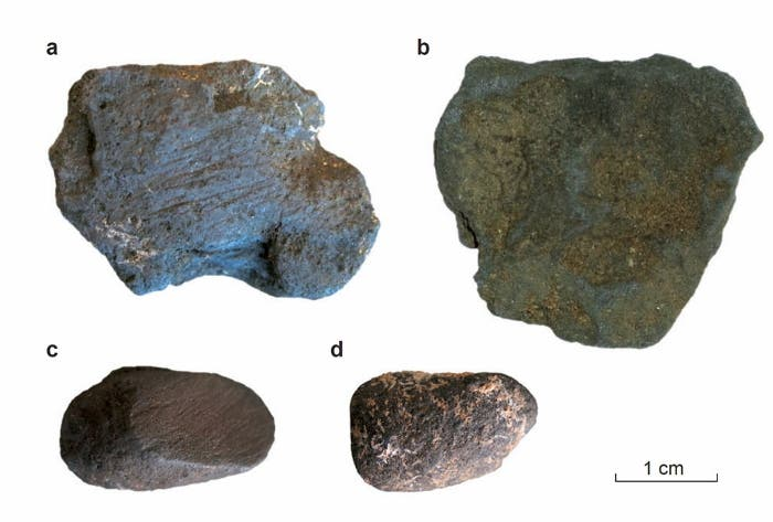 Manganese dioxide blocs from Pech de l'Azé (France), both unmodified (b and d) and abraded (a and c). Image by Peter Heyes