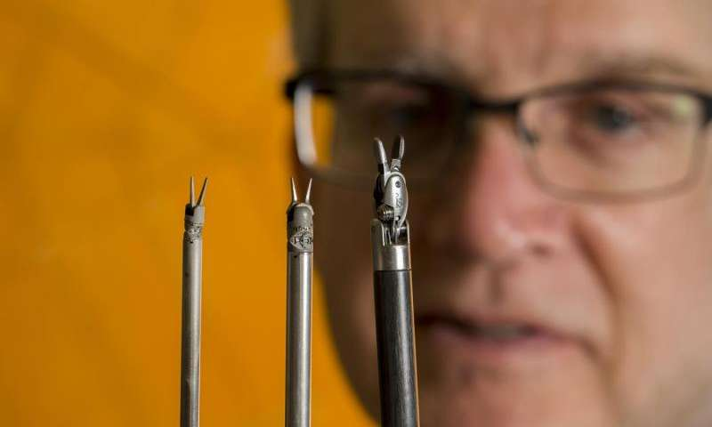 BYU Professor of Mechanical Engineering Spencer Magleby looks over origami-inspired surgical devices. Credit: Mark Philbrick