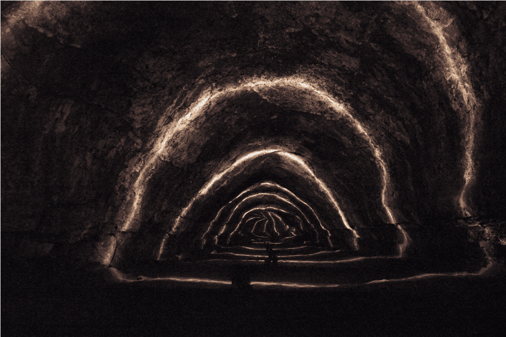Long exposure picture of a lava tube near Bend, OR. The lighting is artificial. Image credits to Michael Harms.
