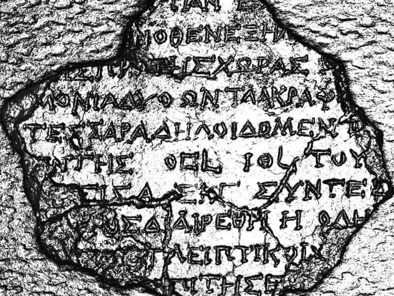 Inscriptions on the back cover of Fragment 19. These were previously obscured by sediments. Credit: Antikythera Mechanism Research Project
