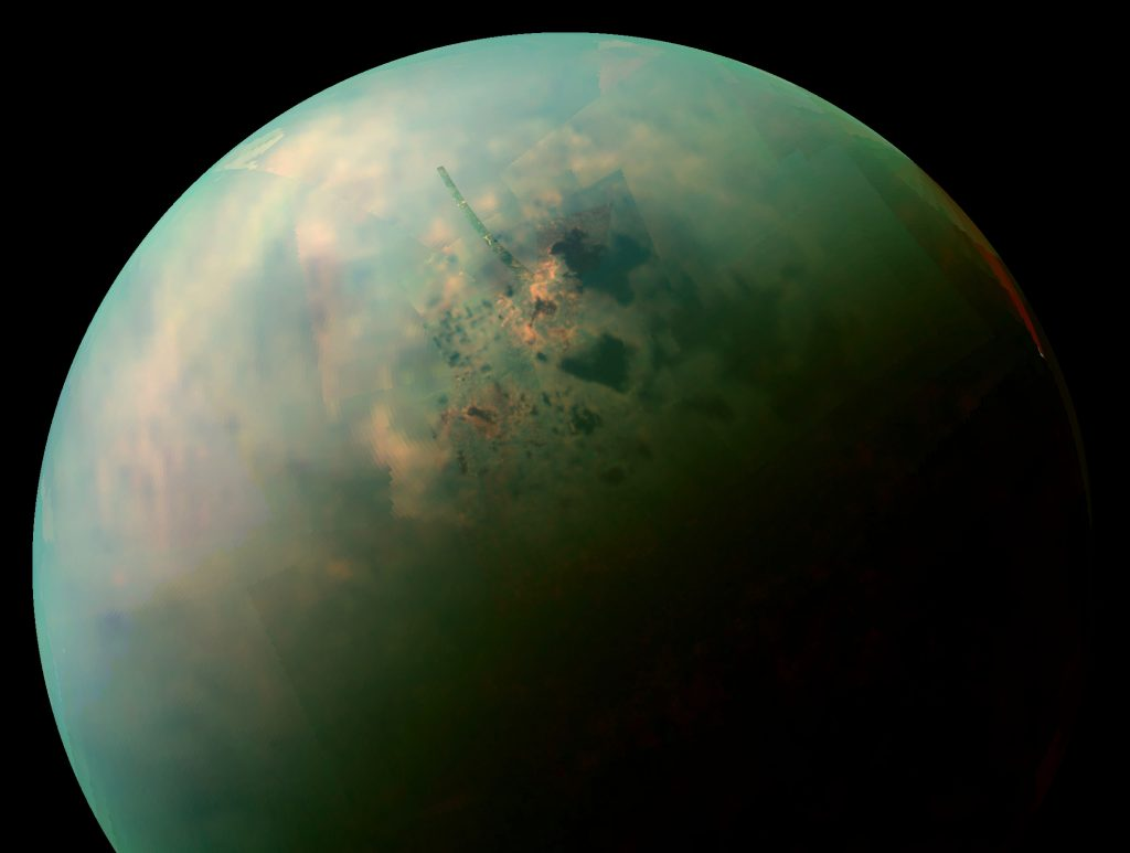 False-color near infrared view of Titan's northern hemisphere, showing its seas and lakes. Orange areas near some of them may be deposits of organic evaporite left behind by receding liquid hydrocarbon. Credit: Wikimedia Commons