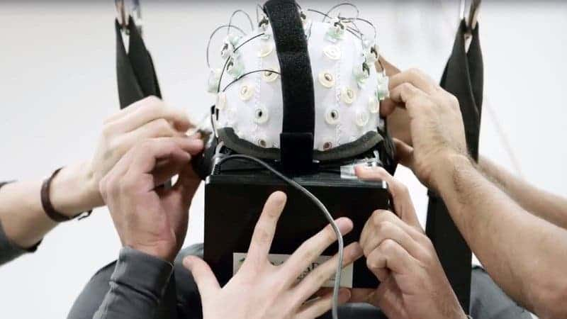 """One of the patients part of the """"Walk Again Project"""" straps a VR headset and EEG cap. This therapy helped many of the patients regain part of their senses, although they used to be completely paralyzed."""