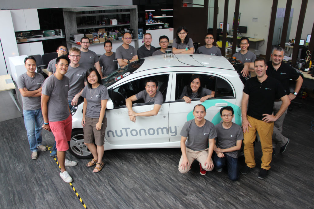 The team behind the autonomous taxis. Image via nuTonomy.