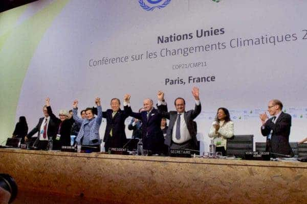 Heads of state cheer after the Paris Climate Change Agreement was signed at COP21, 2015, by 197 parties. Credit: Wikipedia