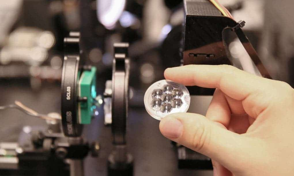 The lenses used to concentrate solar power onto the cell. Credit: Credit: EPFL/Alain Herzog