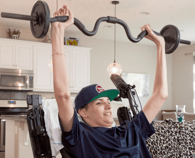 Kris Boesen, pictured pulling weights three months after his surgery involving an experimental stem cell procedure. Credit: USC