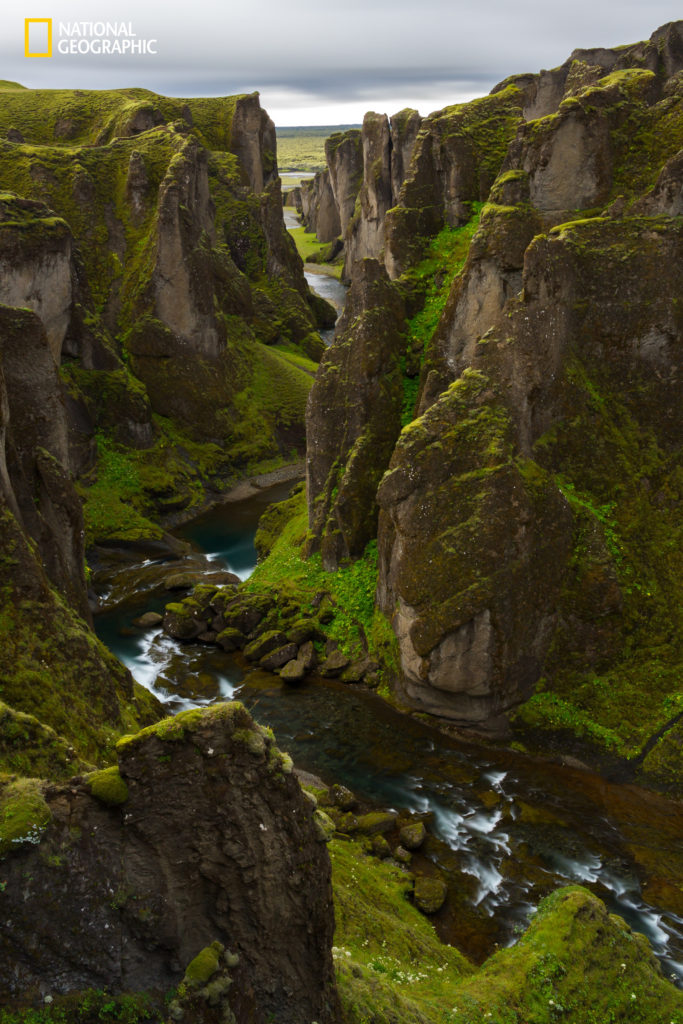 """Image credits Alejandro S. / 2016 National Geographic Nature Photographer of the Year. """"Long exposure shot taken from the top of Fjar·rglj˙fur Canyon Trail. The the moss covered cliffs surrounding the river shows how calm and lively mother nature can truly be,"""" Alejandro S. said."""