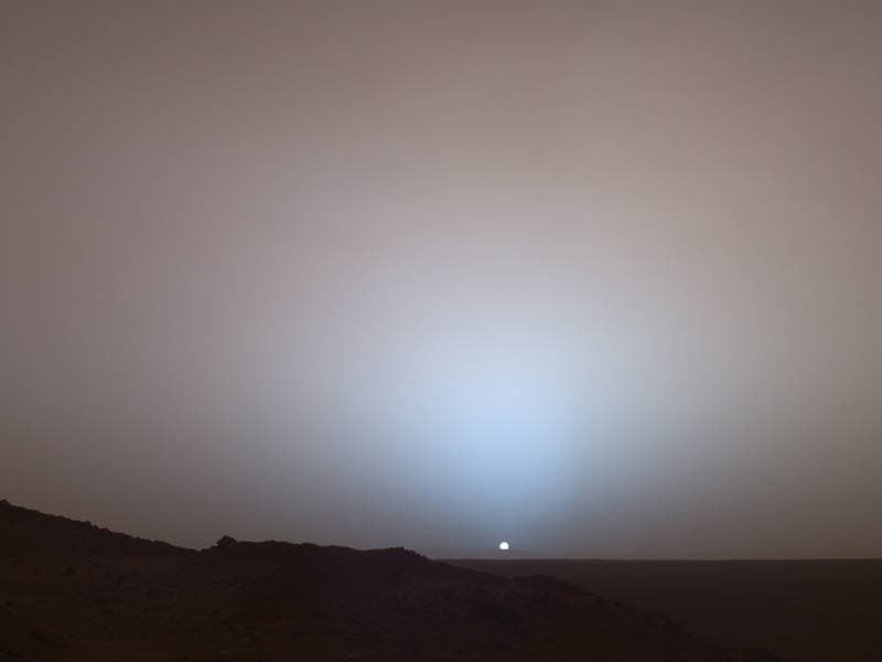 On May 19, 2005, NASA's Mars Exploration Rover Spirit captured this stunning view as the Sun sank below the rim of Gusev crater on Mars. This Panoramic Camera mosaic was taken around 6:07 in the evening of the rover's 489th Martian day, or sol. Credit: Image Credit: NASA/JPL/Texas A&M/Cornell