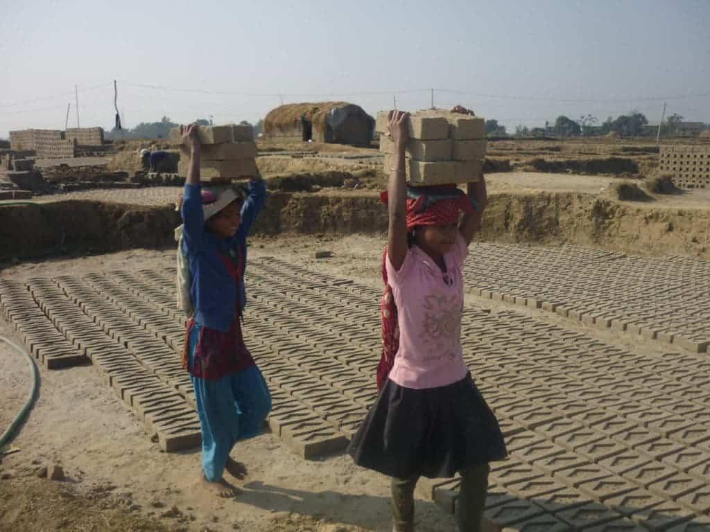 Nepali girls working in brick factory. Credit: Wikimedia Commons