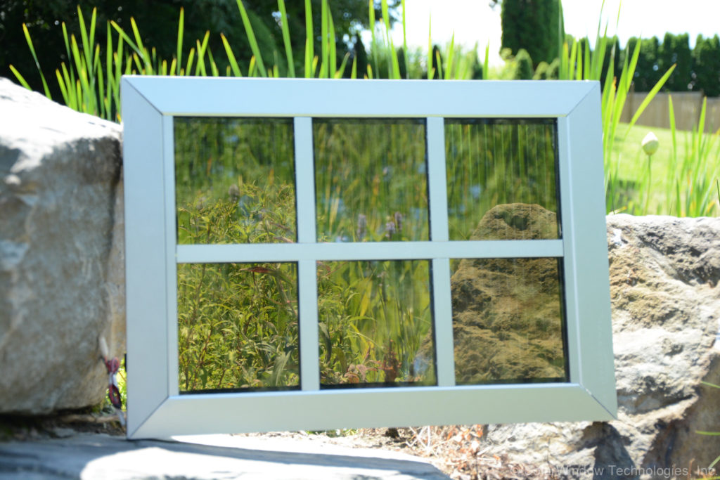 SolarWindow™ module in neutral colors. Image captions SolarWindow.